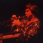 Jeff Elliott playing trumpet during the opening act for Taj Mahal at UCSB, 1980