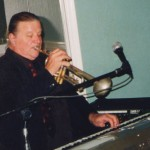 Jeff Elliott playing trumpet and keyboard